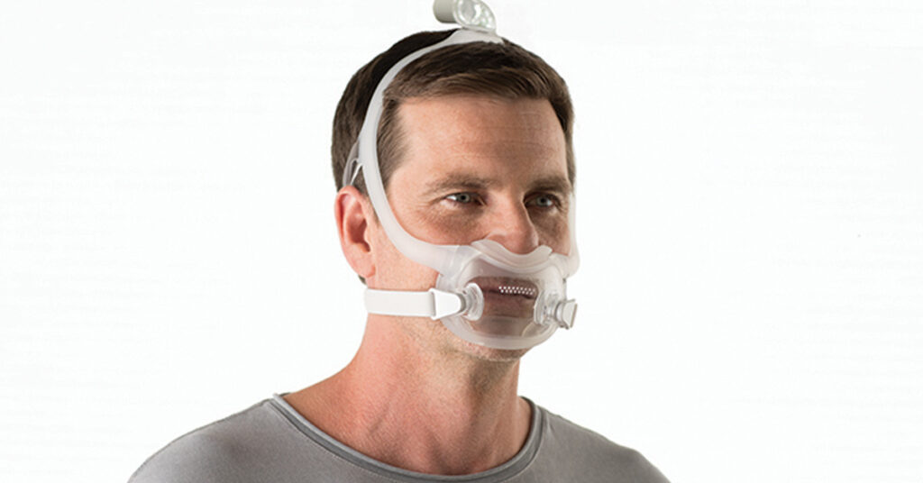 Photo of a person wearing a Full Face CPAP Mask