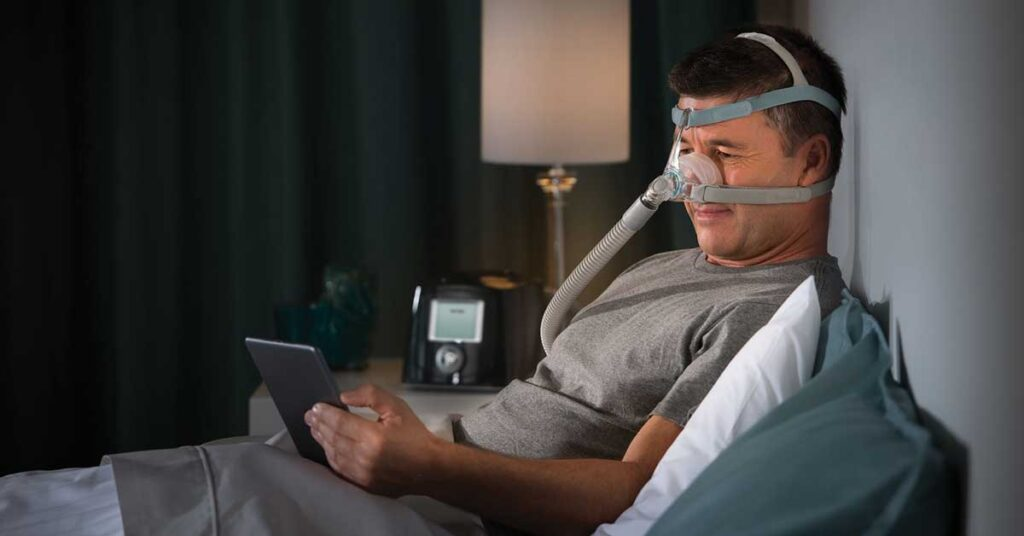 Photo of a person wearing a Nasal CPAP Mask